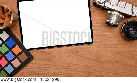Top View Of Professional Photographer Desk With Digital Graphic Tablet Blank Screen Mockup, Camera,