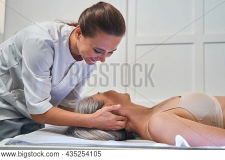 Positive Delighted Osteopath Working In Wellness Center