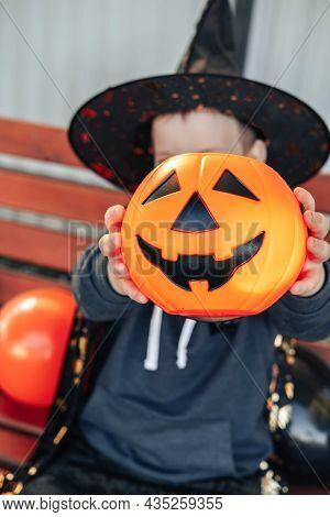 Halloween Kids. Candy Basket Jack O Lantern. Cute Little Boy, Child Wearing Witch Hat With Orange Ja