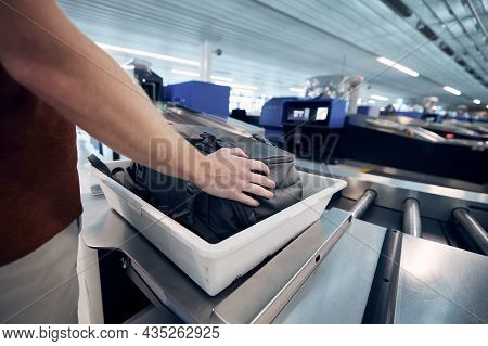 Airport Security Check. Young Man Waiting For X-ray Control His Bag.