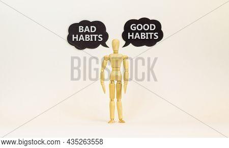 Good Or Bad Habits Symbol. Wooden Model Of Businessman Human. Black Paper. Words Good Habits Bad Hab