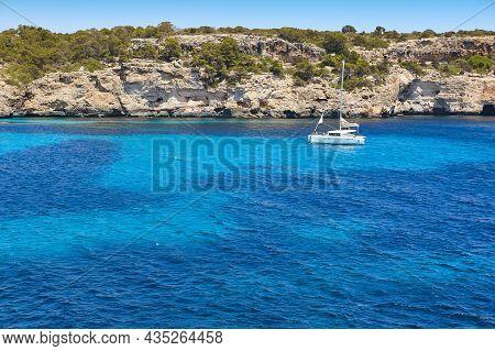 Turquoise Waters In Mallorca. Moro Cove. Mediterranean Coastline. Spain