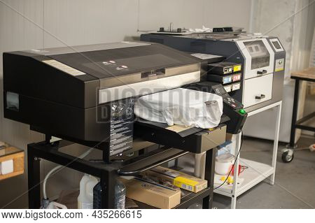 Digital T-shirt Printing Heat Press Machine In Printing Production Shop. No People. Nobady