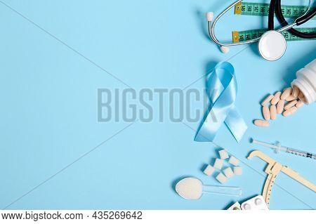 Scattered Pharmaceutical Pills, Insulin Syringe, Stethoscope, Caliper, Measuring Tape, Refined White