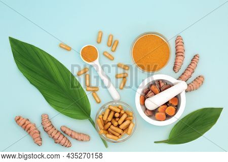 Turmeric health food with powder, dietary supplement capsules and leaves. Used in seasoning and natural herbal medicine. Is anti inflammatory, an antioxidant and has many health benefits.