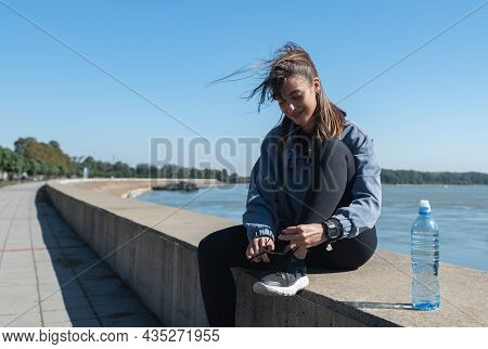 Young Happy Fitness Runner Woman Tying Her Shoes Prepare For Run And Jogging Outdoor On The Sunny We