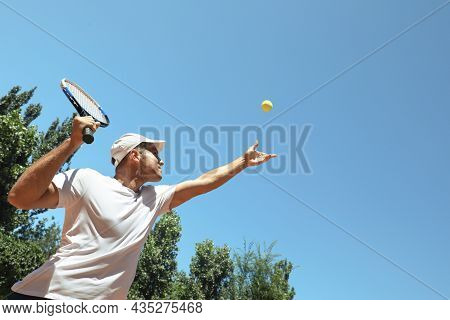 Man Playing Tennis On Court, Low Angle View