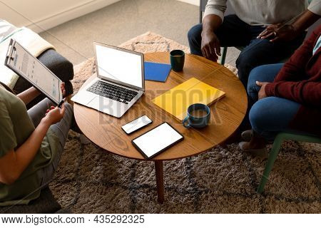 African american senior couple meeting with asian financial advisor using laptop with copy space. retirement lifestyle, elderly support and spending time at home.
