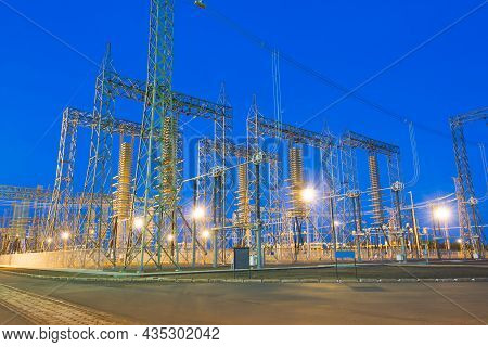 Illuminated View Of An Electric Substation At Night