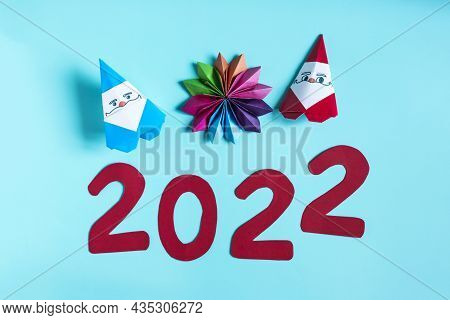 Paper Santa Claus And Paper Decor On A Light Background. Origami Painting Figures 2022 And Paper Fig