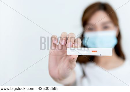 Blurred Images Of Woman Showing Test Results Of Rapid Antigen Test Covid-19, Showing No Infection, O