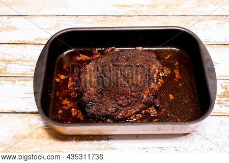 Piece Of Pork Rubbed With A Rub And Cooked On The Barbecue To Make A Pulled Pork.