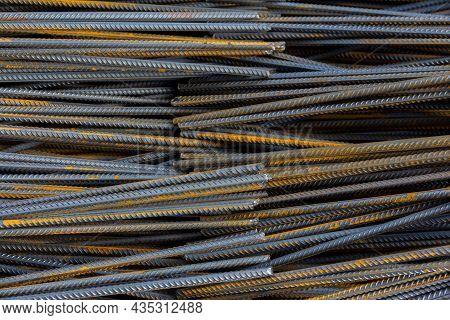 Steel Rebars For Reinforced Concrete. Steel Reinforcement Bar Texture In Construction Site.
