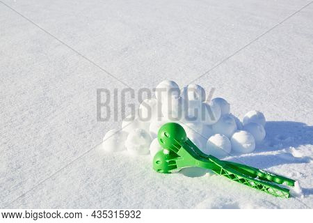 A Children Toy Is A Tool For Modeling Snowballs From Snow. Green