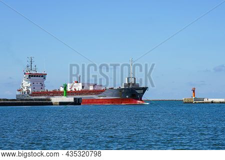 The Cement Transport Vessel Enters The Port Through The Breakwater Gate