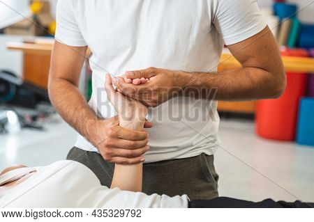 Woman During A Physiotherapy Treatment. Rehabilitation Therapy For Injured Elbow And Hand Wrist.