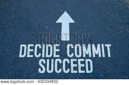 Business Concept. On The Asphalt Road Markings An Arrow With The Inscription - Decide Commit Succeed