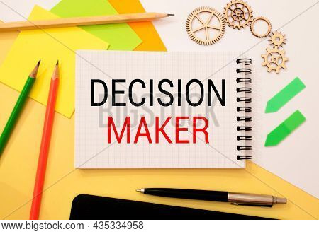 Closeup On Businessman Holding A Card With Decision Maker Message, Business Concept Image With Soft