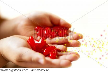 Little Child Holding Red Hearts, Close Up Isolated And Energy With Sparkle On White Background. Heal