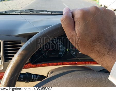 Long Drive In A Car Hand On Steering Wheel