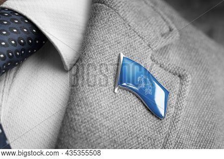 Metal Badge With The Flag Of Semeral Postal Union On A Suit Lapel