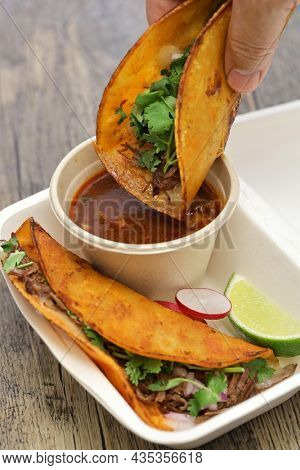 birria tacos with broth for dipping, mexican food