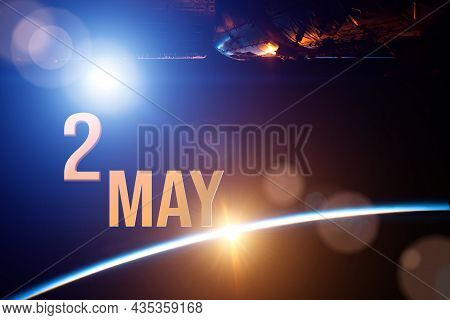 May 2nd. Day 2 Of Month, Calendar Date. The Spaceship Near Earth Globe Planet With Sunrise And Calen