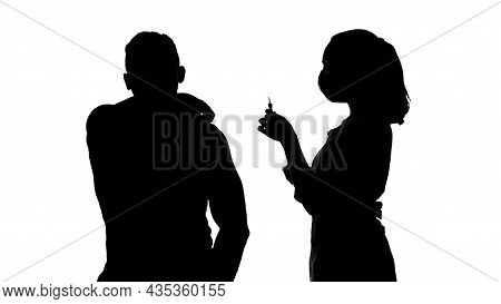 Photo Of Woman Making Injection In Mans Forearm