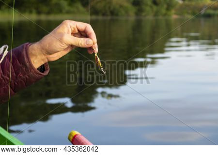 Fishing Lure Held In Hand, Spinner With A Triple Hook, A Fishing Lure Is A Type Of Artificial Fishin