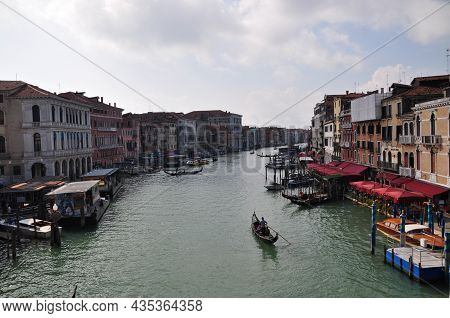 Panoramic View Of The Canal With A Pier Along The Embankment. Gondolas Float Along The Canal. ... Oc