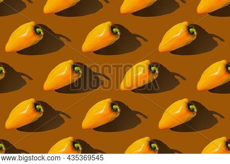 Bell Pepper With Shadow On Brown Background. Paprika Pattern. Autumn Concept.