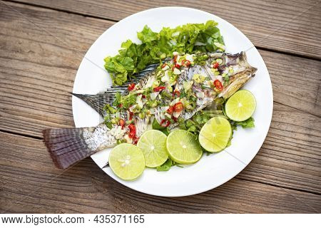 Steamed Tilapia Fish With Chili And Lime Lemon Sauce With Herb And Vegetable On Plate, Fish Steam Li
