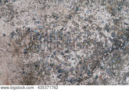 Cement Floor With Small Stones. Dirty Cracked Old Gray Concrete Background Wall Or Floor With Polish