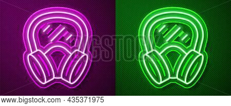 Glowing Neon Line Gas Mask Icon Isolated On Purple And Green Background. Respirator Sign. Vector