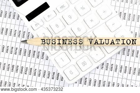 Text Business Valuation On Wooden Pencil On Calculator With Chart