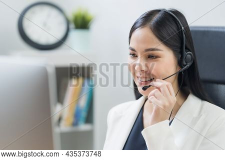 Young Business Asian Woman Working Call Centre Customer Service Agents. Business Female Support Oper