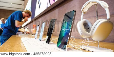 Paris, France - Sep 24, 2021: Row Of New Smartphones In Apple Store With Iphone 13 Pro And An Iphone