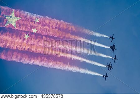 China Air Forces Strike Concept. Fighter Aircrafts With China Flag Contrail