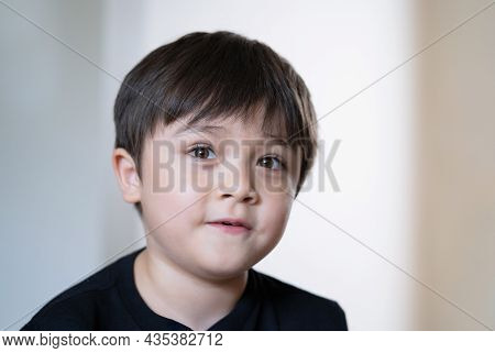 Close Up Face Cute Happy Child Boy Looking Up With Surprised Face, Head Shot Positive Kid With Smili