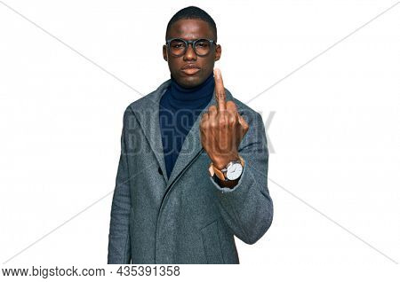 Young african american man wearing business clothes and glasses showing middle finger, impolite and rude fuck off expression