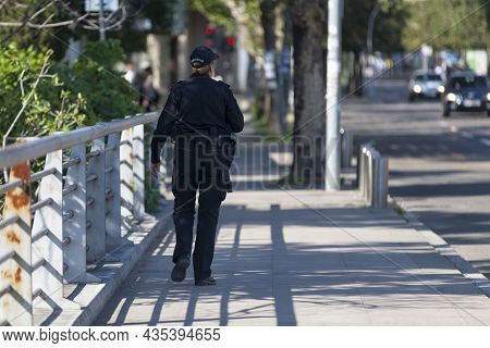 Podgorica, Montenegro - April 20 2019: Policewoman (policija) Waiting At A Cross Walk.