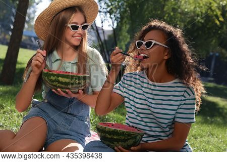 Happy Girls Eating Watermelon On Picnic Blanket In Park