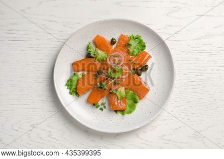 Salmon Carpaccio With Capers, Lettuce, Microgreens And Onion On White Wooden Table, Top View