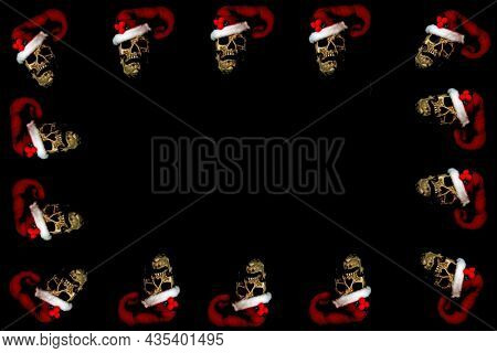 Christmas and Halloween Human Skull Picture Frame. Evil Christmas Skull. Human Skull with a Santa Claus Hat. Isolated on black. Evil Claus. Halloween Menu Board.