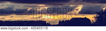 Sunset Cityscape. Silhouette Buildings Against An Orange Sky. City View At Sunset. Bright Orange Sky
