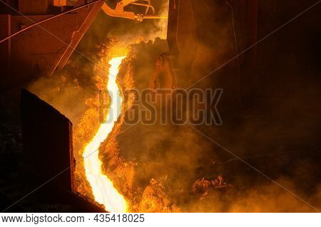 The Flow Of Molten Hot Metal, Molten Steel Flows Along The Guide Chute. Blast Furnace Metal Tapping.
