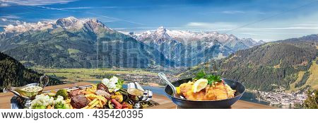 Typical Austrian Food With Panorama Of Tauer Alps With Kitzsteinhorn Peak Over Zell Am See Town In A