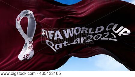 Doha, Qatar, October 2021: A Flag With The 2022 Fifa World Cup Logo Flapping In The Wind. The Event