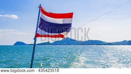 The National Flag Of Thailand In Rough Wind Blue Sky.