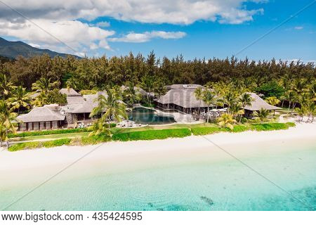 Luxury Beach With Hotel Resort In Mauritius. Sandy Beach With Palms And Blue Ocean. Aerial View